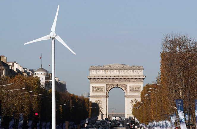 A wind turbine is installed to provide electricity for Christman illuminations on the Champs-Elysee on November 26,2015 in Paris,France.