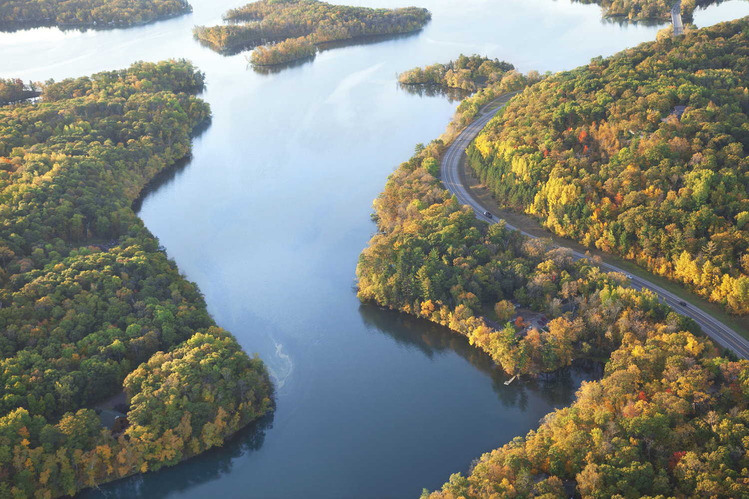 a view of the Mississippi River surrounded by trees