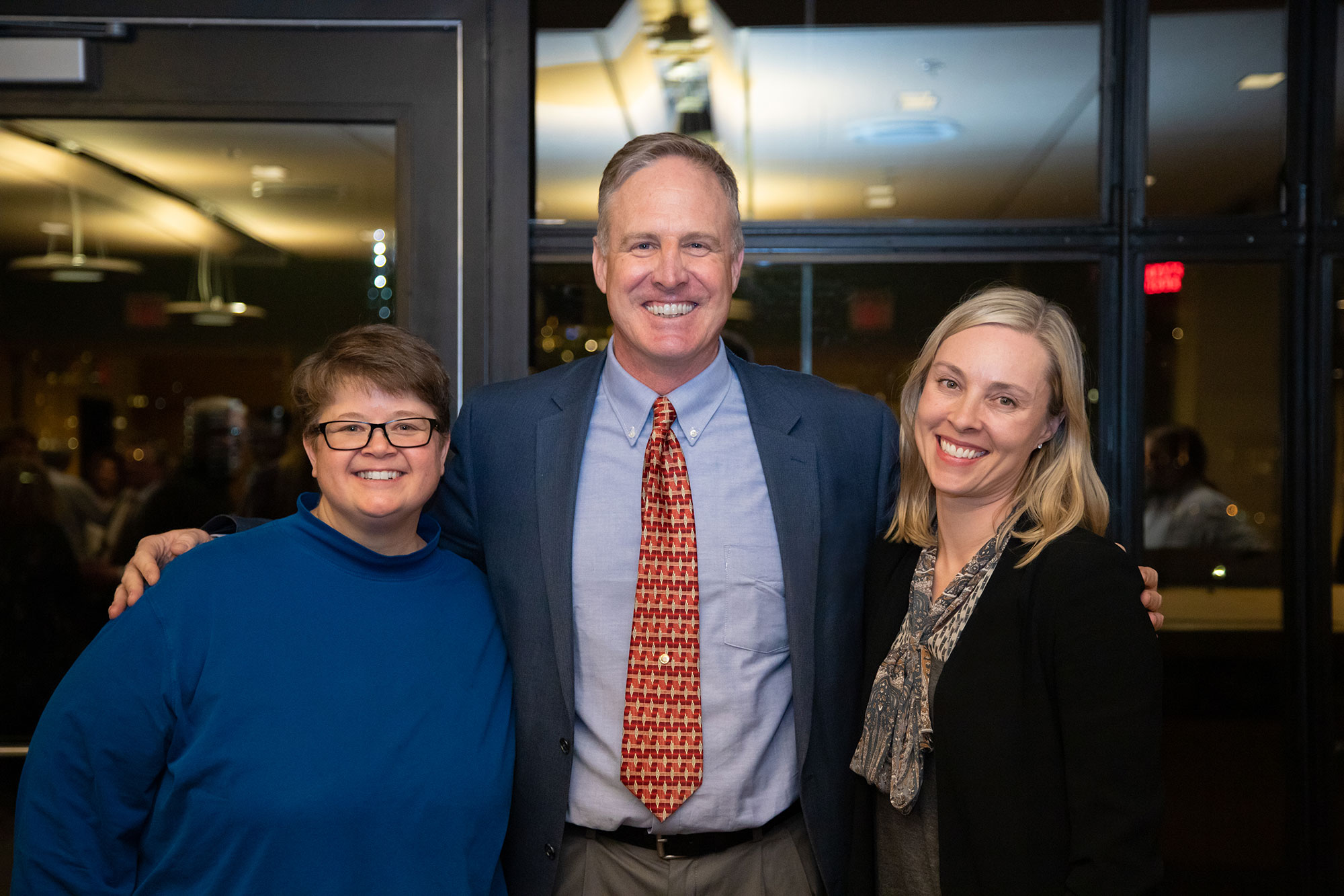 "Sarah ""Sam"" Marquardt, Mark Muller, and Julia Olmstead pose for a photo at the Mississippi River program celebration. Photo Credit: Molly Miles"