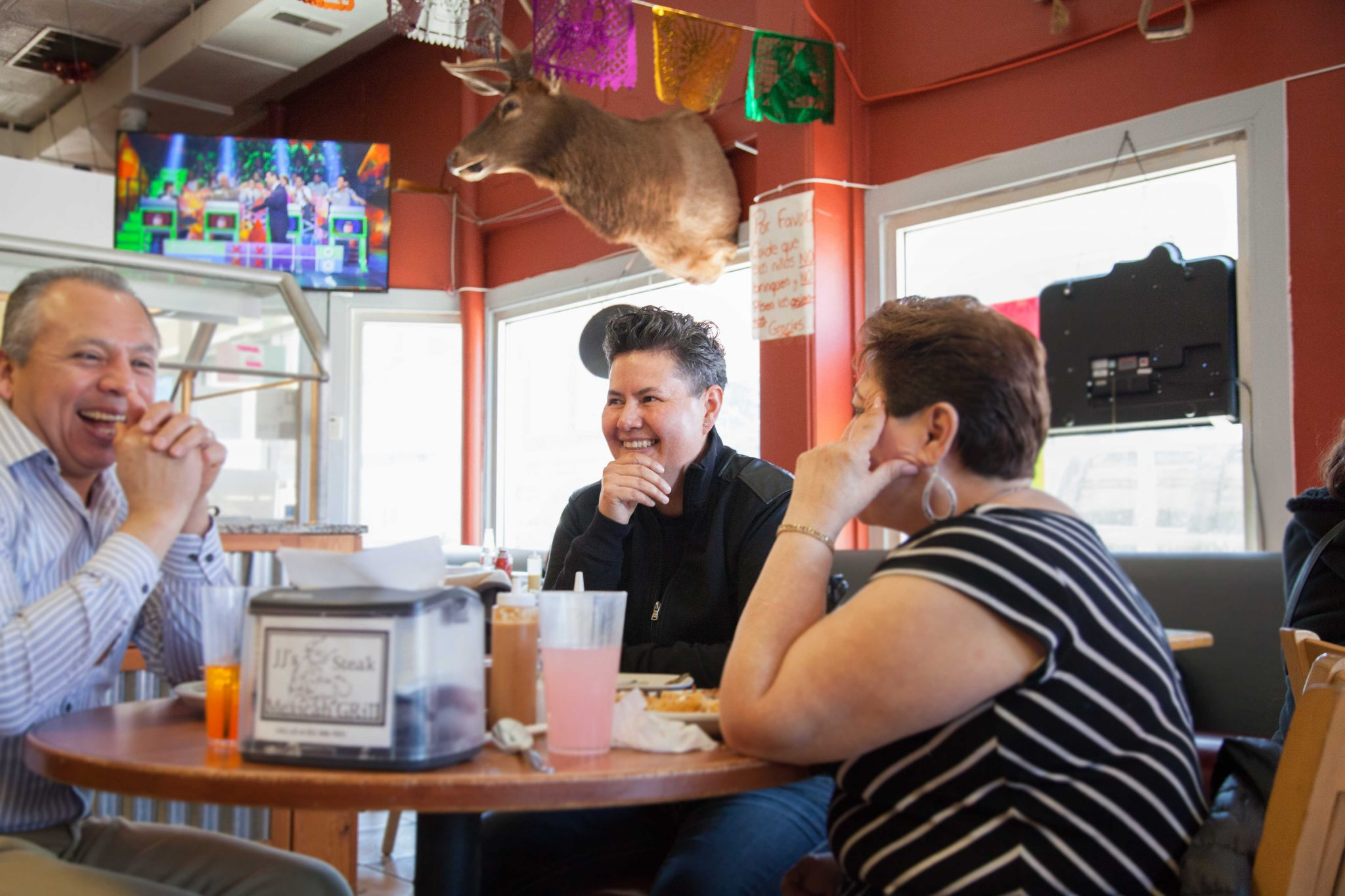 Plaza Del Sol owner Sonia Ortega (center) sits down to chat with customers.