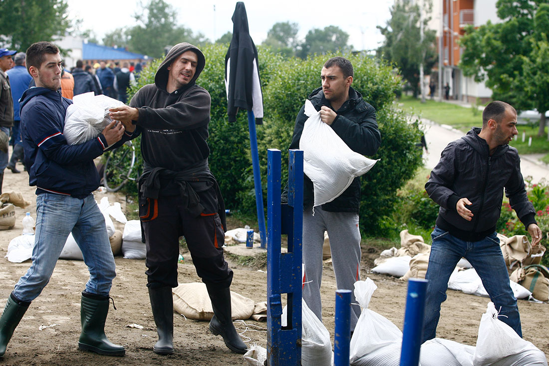 Think of project work as individual sandbags that collectively prevent flooding and drive transformational change. Photo credit: iStock.com/nemar74